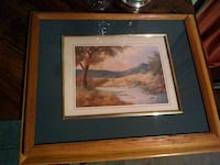 brown wooden framed painting of house Kingman
