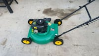 green and black push mower 145 mi