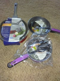 three sets of Oster frying pans with flipping spatulas
