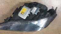 Used OEM Right side head light off on a 2006 BMW District of Columbia