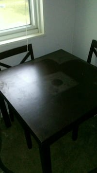 rectangular brown wooden table with chairs 26 mi