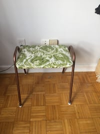 green and white floral padded chair