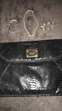 Michael Kors purse / 2 bracelets one gold in color the other , tennis bracelet is sterling silver with blue Ruby's, also sterling silver necklace Pearl, 39208