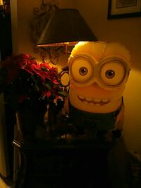 red and black Minion plush toy
