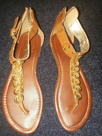 pair of brown leather thong sandals
