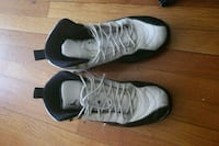 pair of white-and-black Nike basketball shoes Yonkers