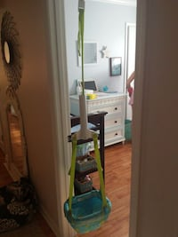 green and blue hanging jumperoo