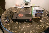 black Xbox 360 console with controller and game ca Toronto, M1B 5K5