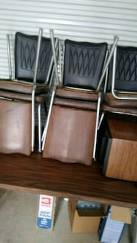 brown and black chairs with gray steel bases