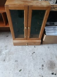 brown wooden framed glass cabinet Silver Springs, 34488