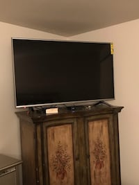 black flat screen TV with black wooden TV stand Rochester Hills, 48307