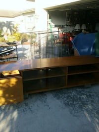brown wooden framed glass top TV stand