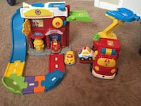 red and blue Fire station toy set