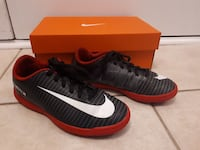 pair of black-red-and-white Nike Mercurial shoes with box