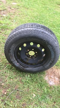 Black car wheel with tire Winchester