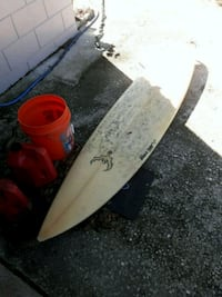 white and red surf board 762 mi