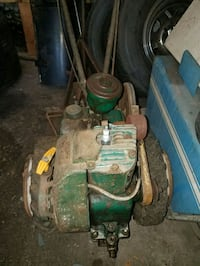 green and black push mower 69 km