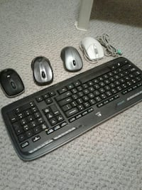 black Logitech computer keyboard with four multicolored computer mouses Surrey, V3T