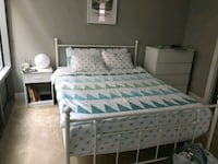white wooden bed frame with white and green comforter set Chevy Chase, 20815