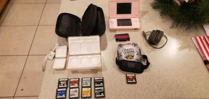 Pink DS lite, 9 games, Guitar Hero Play Pak, & 2 Game Cases