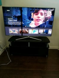 black flat screen TV with black wooden TV stand 3154 km