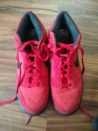 pair of red Nike running shoes Milwaukee, 53233