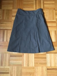 two gray and one black skirts