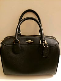 women's black Coach leather tote bag 9 km