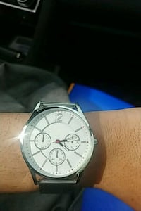 round silver chronograph watch with black leather strap Manalapan Township, 07726