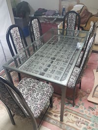 Glass diner table with 6 chairs good condition. Kitchener