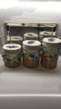 four white-and-green floral ceramic canisters 3741 km