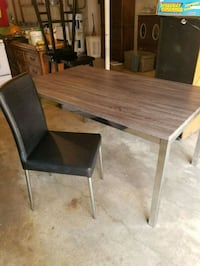 Dining room table with 6 leather black chairs Nashville, 37211