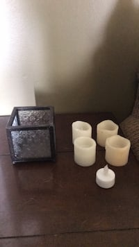 Glass with 4 wax battery candels plus smaller plastic candle  Whitehall, 18052