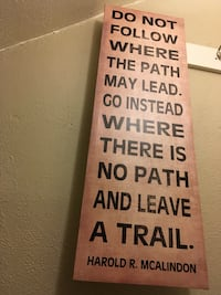 brown and black wooden quote board