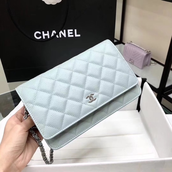 857adb63ba27 Used quilted white and black Chanel leather crossbody bag for sale - letgo