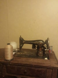 brown and black treadle sewing machine null