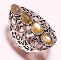 silver-colored ring with clear gemstones Montreal, H8T