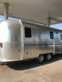 White and blue camper trailer Wellington, 80549