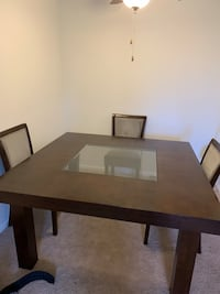 Rectangular brown wooden table with four chairs dining set Manassas, 20111