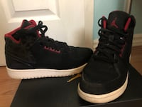 Pair of black-and-red air jordan shoes