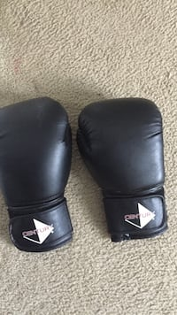 pair of black Century boxing gloves Port Saint Lucie, 34953