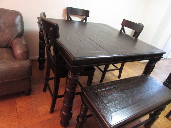 Ashley solid wood dining table with 4 chairs and a bench