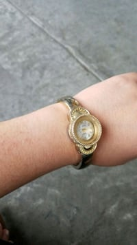 round gold-colored clip on watch 2264 mi