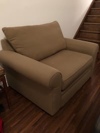 Brown wooden framed white padded armchair Toronto, M6H 2W7