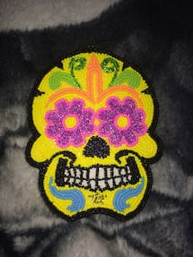 Beaded skull medallion