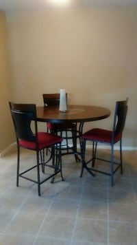 round brown wooden table with four chairs dining set Houston, 77067