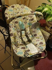 baby's white, gray, and green Cosco bouncer