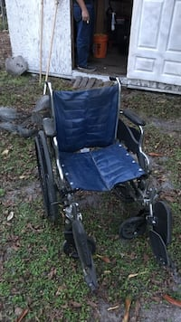 Black, gray, and blue folding wheelchair