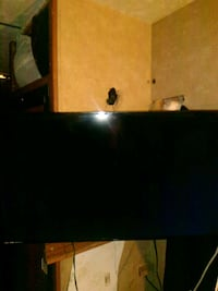 black flat screen TV with remote 2210 mi