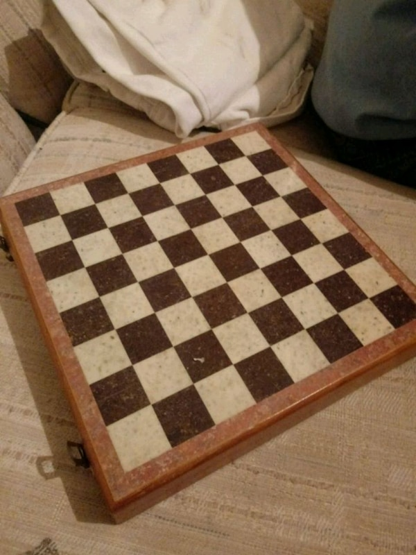 Chess Board With Marble Game Pieces